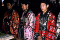 Men in traditional dress, leading prayers at the White Cloud temple in Beijing.