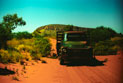Old Bedford truck travelling on an unsealed road in the outback.