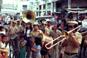 Marching band performing in the street.