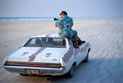 Cinematographer, David Batty, filming from on top of Ford Fairlane whilst driving down a beach.