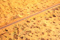 Aerial view of road in an outback landscape.