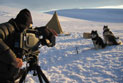 Cinematographer Wade Fairley films a recreation scene of Mawson and Mertz' 1912 Antarctic expedition.