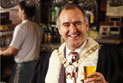 Larry Hand, former Lord Mayor of Sydneys Leichhardt Council holding a glass of beer.