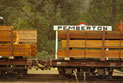 Timber being transported by a goods train.